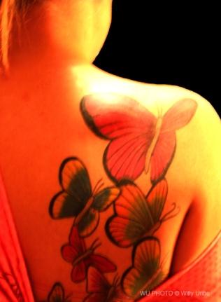 Butterfly tattoo WU PHOTO © Willy Uribe Archivo fotográfico Reportajes